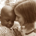 small african american child with caucasian mother.