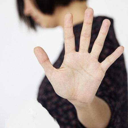 Woman stop talking hand gesture